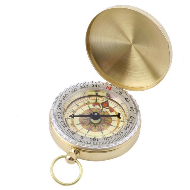 Kompas v uzatvárateľnom kovovom puzdre