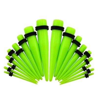 Akrylátový rozťahovák do ucha svetlo zelený