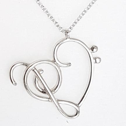 Strieborná retiazka s príveskom husľový kľúč a srdce 6c49e200983