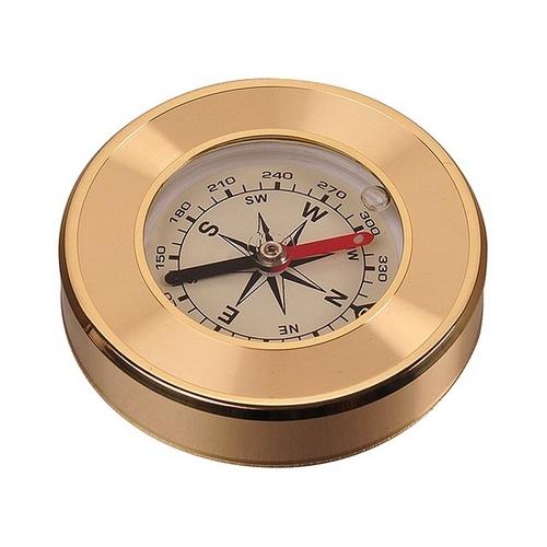 Pozlátený kovový kompas