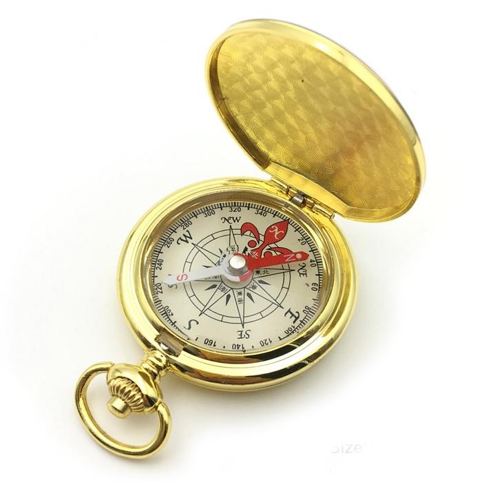 Pozlátený kompas v uzatvárateľnom kovovom puzdre