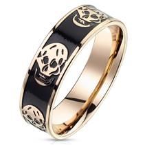 Zlacený ocelový prsten s lebkami